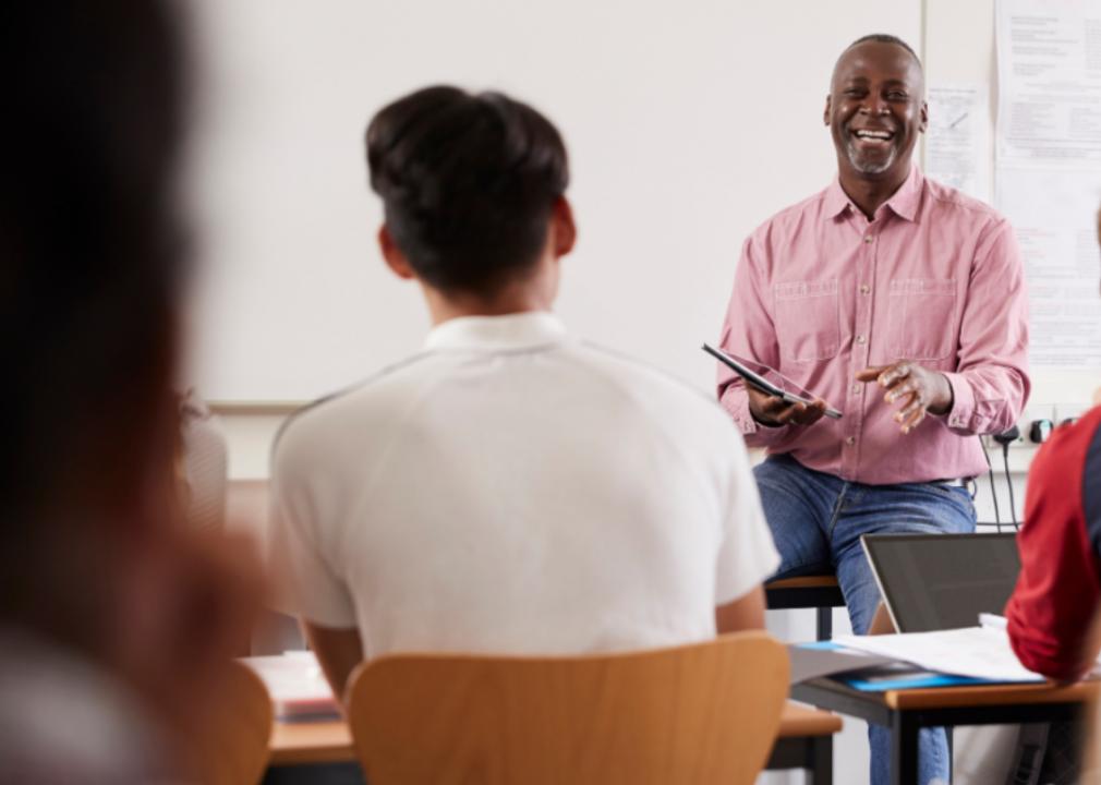 A professor addresses a classroom full of students