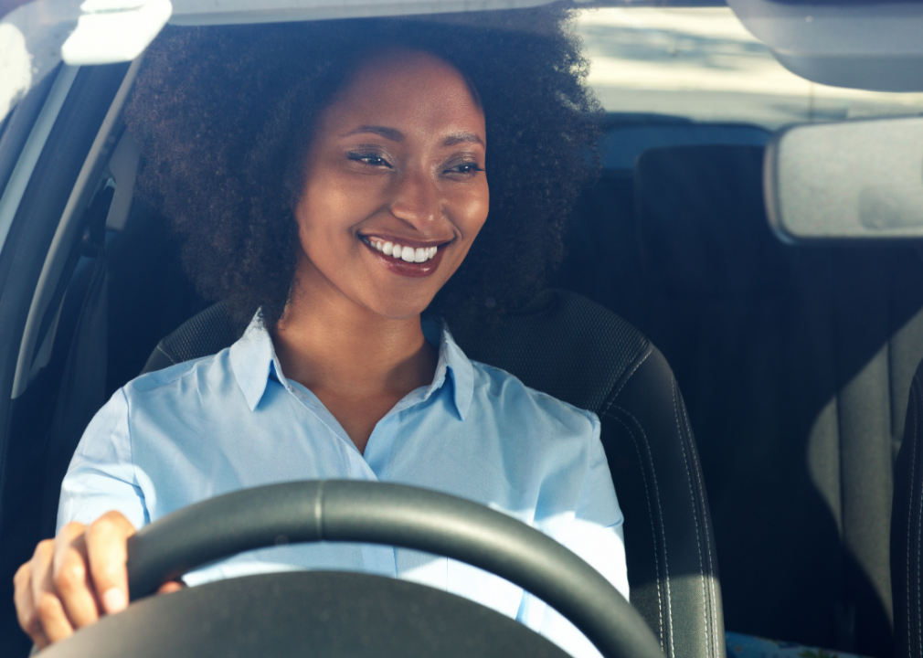 Photo of smiling woman driving a car