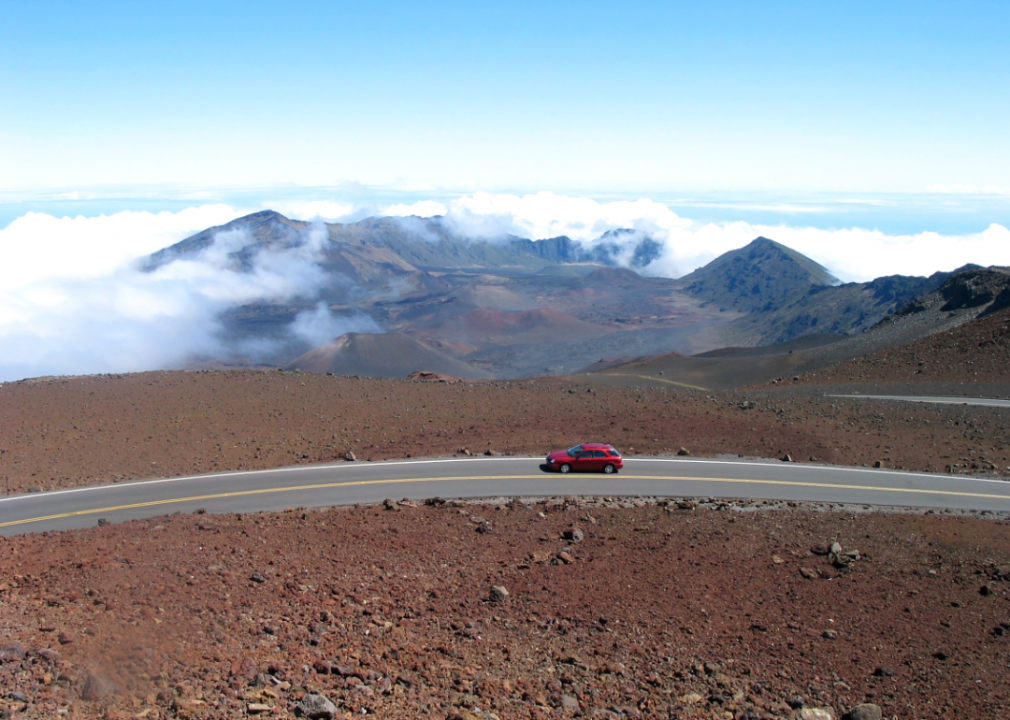 Photo of a car on a remote mountain road