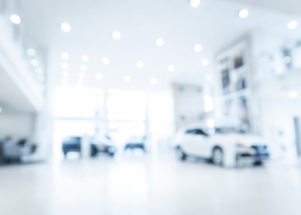 Out-of-focus photo of car dealership interior
