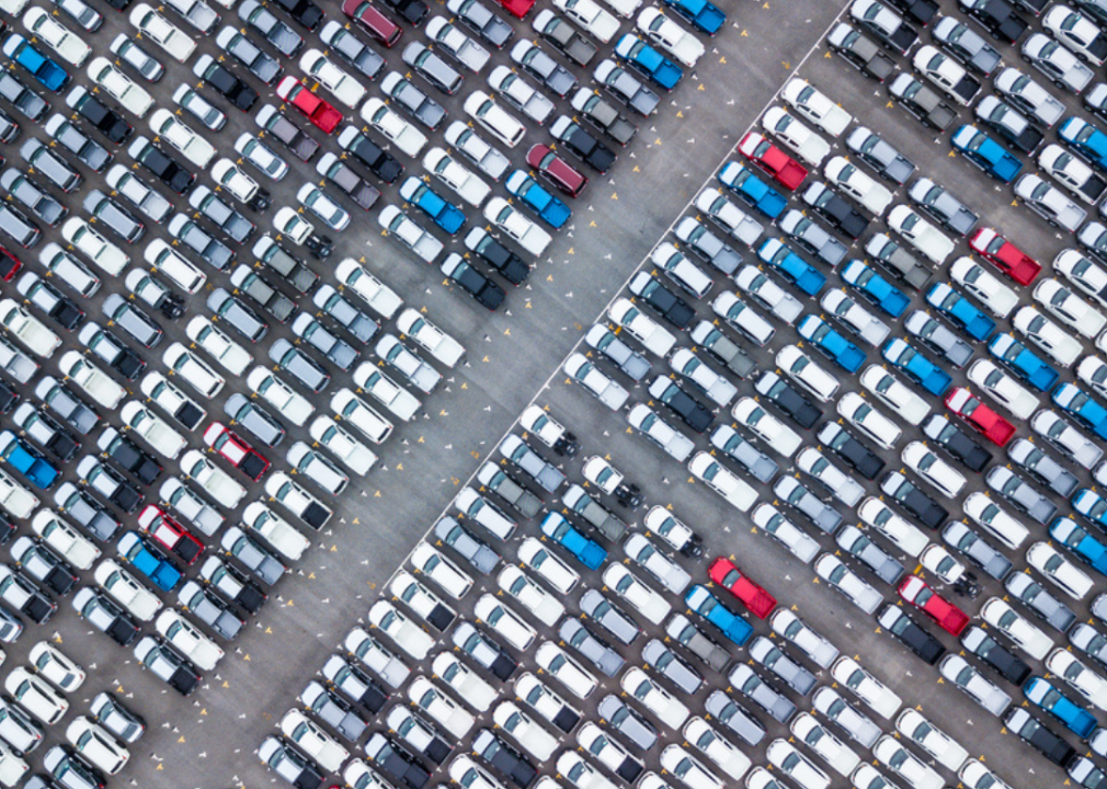 High-angle photo of many cars in a parking lot