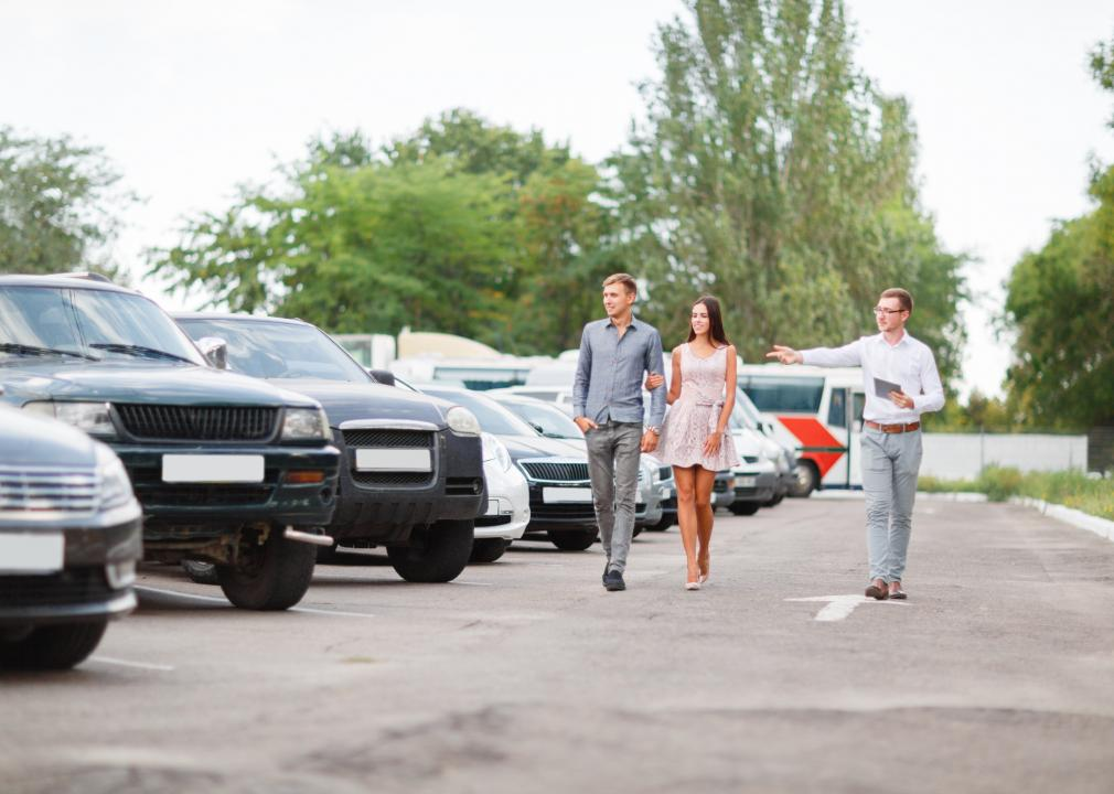 Photo of customers looking at used cars